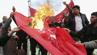 Protesters in Basra, Iraq, burn Turkish flag during demonstration calling for withdrawal of Turkish troops from northern Iraq. 18 Dec 2015