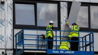 Cladding being removed from building