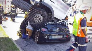 A picture of the truck that landed on top of a car in the South African city of Port Elizabeth