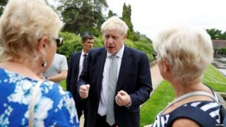 Boris Johnson speaks to members of the public on a visit to the Royal Horticultural Society as Wisley
