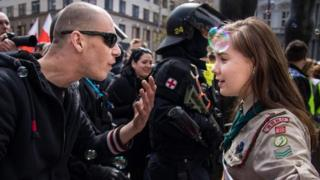 Lucie Myslikova (right) stands up to a far-right protester in the Czech Republic