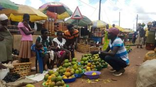 Lawrence talking to market traders