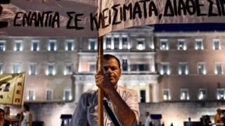 Protesters outside parliament in Athens on 22 July 2015