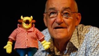 Jim Bowen with Bullseye mascot Bully