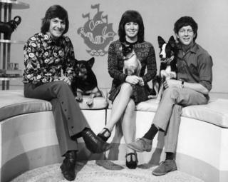 Peter Purves with Petra the dog, Valerie Singleton holding Jason, the Siamese cat and John Noakes with Shep the dog, on Blue Peter
