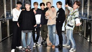 V, Suga, Jin, Jungkook, RM, Jimin, and J-Hope of the K-Pop Group BTS visit The Empire State Building on May 21, 2019