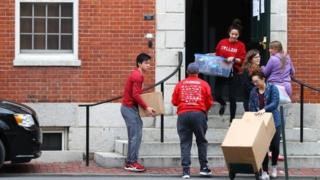 Students move out of dorm rooms on the campus of Harvard University last month