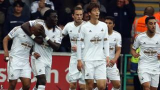 Swansea players celebrate Andre Ayew's opening goal