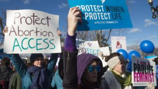 Supporters of legal access to abortion rally outside the Supreme Court in Washington, DC.
