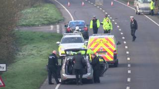 Police attend the scene on the A39