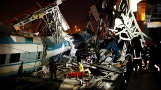 Rescue workers search the wreckage for survivors