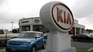 Kia logo at a Hyundai dealership in the US