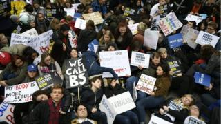 """Supporters of stricter gun control stage a """"die in"""" during a solidarity rally with """"March For Our Lives"""" outside the U.S. Embassy in London, Britain"""