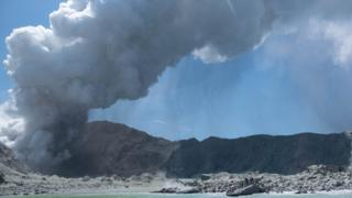 A handout photograph courtesy of Michael Schade shows the volcano on New Zealand's White Island spewing steam and ash minutes after an eruption.