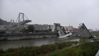 Wide shot shows large section of bridge collapsed, with remaining part exposed