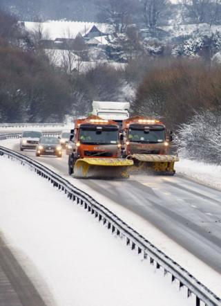 Snowploughs seen on clearing a snow-covered.
