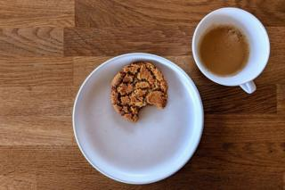 Ginger biscuit and cup of coffee