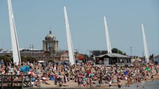 People are seen on the beach in Southend following the outbreak of the coronavirus disease (COVID-19), Southend, Britain, May 25, 2020