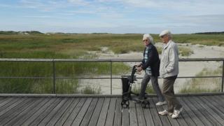An elderly couple on the German North Sea coast