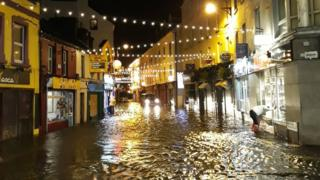The storm has also hit Ireland - this Christmassy street in Galway was flooded.