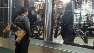 Mohammet Hussein staring through the window of a gym in Turkey