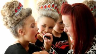 Competitors preparing their makeup