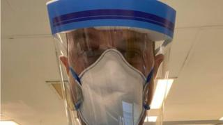 Dan Harvey wearing coronavirus protective equipment