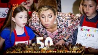 Queen Maxima blows out candles