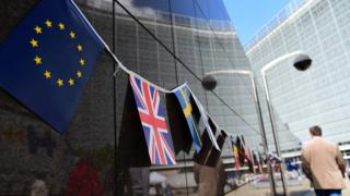 Flags of EU, UK, other European countries hang outside the EU Commission building in Brussels