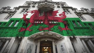 Welsh flag superimposed on the Supreme Court