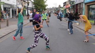 Hula hoopers on Mill Road, Cambridge