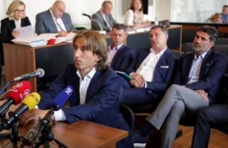 Croatia and Real Madrid midfielder Luka Modric for court last June
