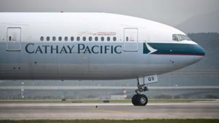 A Cathay Pacific passenger plane prepares to take off from Hong Kong's international airport on March 13, 2019