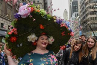 A person wears an large Easter bonnet in New York City