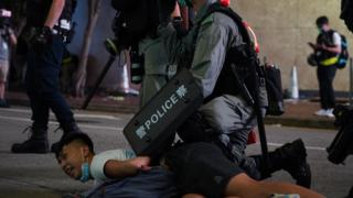 A protester is arrested in Hong Kong on 1 July 2020
