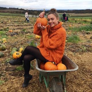 Sarah Alexandra posing with her pumpkin