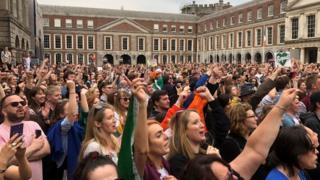 crowds celebate outside Dublin Castle