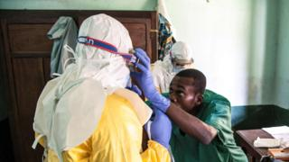 Health workers wear protective equipment as they prepare to attend to suspected Ebola patients at Bikoro Hospital on 13 May 2018