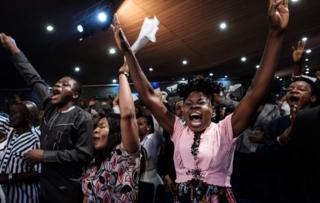 Worshipers from the Nigerian Pentecostal church Salvation Ministries attend the 5th Sunday service at their church headquarters in Port Harcourt, southern Nigeria, on February 24, 2019