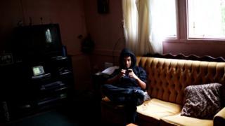 young man on sofa