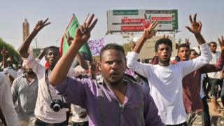 """Sudanese protesters gather for a """"million-strong"""" march outside the army headquarters in the capital, Khartoum, on 25 April 2019."""