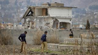Policemen stand guard near the partially demolished compound where al Qaeda leader Osama bin Laden was killed by US special forces last May, in Abbottabad this February 26, 2012 file photo.