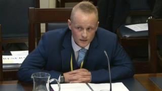 Jamie Bryson at Stormont's Finance Committee in 2016