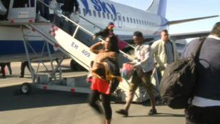 A pregnant Cuban woman disembarks from plane in Mexico