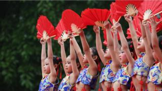 Kindergarten students dance during a Chinese traditional culture performance at Wusheng County on May 10, 2017 in Guang'an, Sichuan Province of China. Items including martial arts, sing and dance, reading poetry, art of tea, writing Chinese calligraphy are performed by about 1,000 kindergarten students to promote Chinese traditional culture.