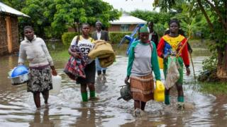 Displaced families flee to higher ground in Kakola village in Nyando sub-county in Kisumu after their houses were flooded on 3 December 2019