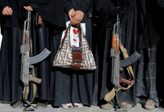 Armed women attend a rally to show support to the Houthi movement in Sanaa, Yemen