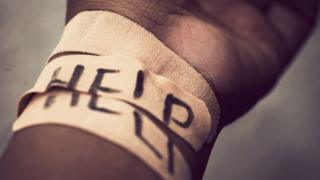 A self harmed wrist covered with bandage