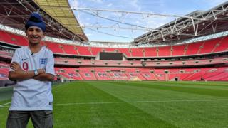 Balraj standing pitch side at Wembley