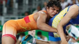 "India's Sakshi Malik (red) wrestles with Kirghyzstan""s Aisuluu Tynybekova"